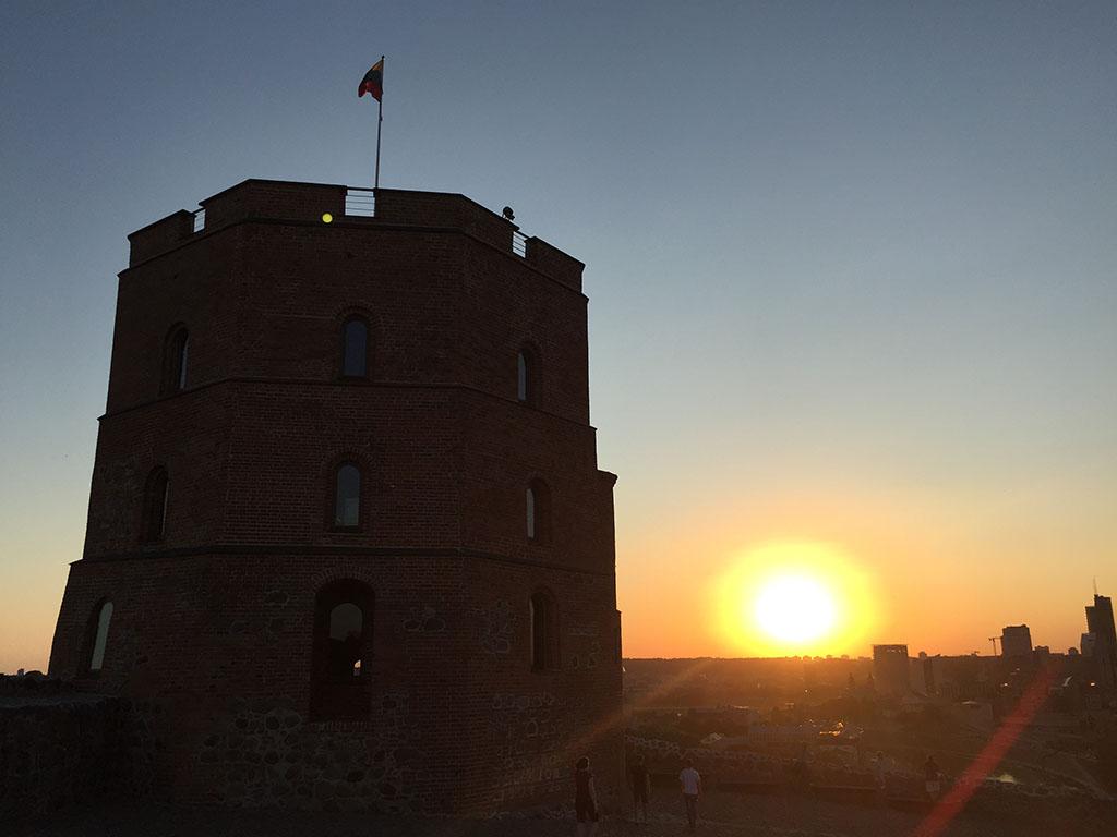 sun sets over vilnius