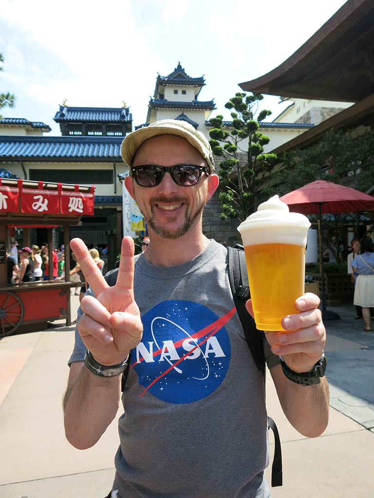 me and a frozen Kirin beer at Epcot (yes, beer slushie)